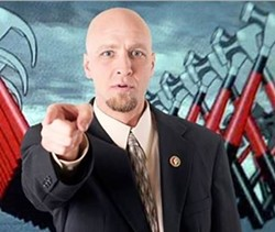 Luke Lamb, shown here in a campaign banner from last year. He's running for Greene County Sheriff now.
