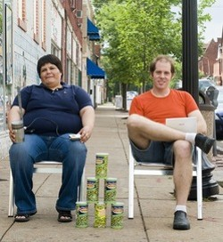 Ben West and Minerva Lopez pose with the cans that inspired WasabiNet - PHOTO BY JENNIFER SILVERBERG