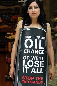 Lush employee Rachael Wall protests mining the Canadian Tar Sands. Click to view larger version.
