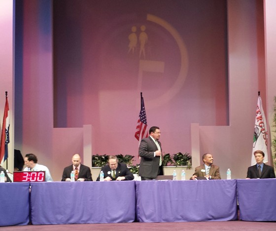 Ferguson City Council enters the sanctuary, Mayor James Knowles standing. - JESSICA LUSSENHOP