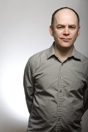 """Todd Barry looking """"playfully fed-up."""" - PHOTO BY FRANCINE DAVETA"""