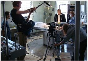 Cropf (far left), cast and crew filming at the St. Louis medical examiner's office. - COURTESY CORNER FILM PRODUCTIONS