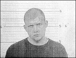 Reggie Allen in a 2005 mugshot. Allen has been charged with some 20 felonies in the past.