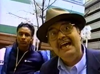 The late Pete Parisi, right, in 1998, with a mall shopper who had just been kicked out of St. Louis Centre.