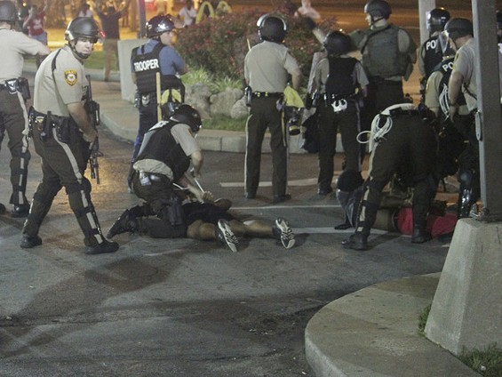 Police arrest protesters in Ferguson Monday night. - DANNY WICENTOWSKI
