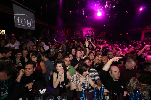 Throngs of drinkers wait for libations at the bar Saturday night during the show for Miami-based rapper Pitbull. See more photos from the show. - PHOTO: NICK SCHNELLE