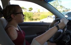 Yes, that is her foot on the steering wheel. - TISHA UNARMED VIA YOUTUBE