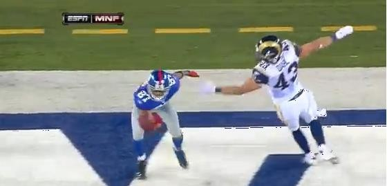 Domenik Hixon makes a heck of a grab at the end of the first half to put the Giants up 21-6. They'd go on to beat the Rams 28-16.
