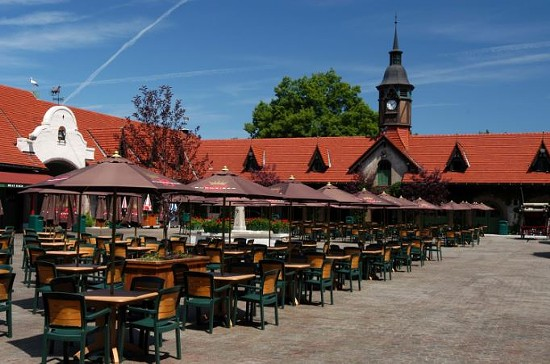 The courtyard outside the Bauernhof, where visitors can indulge their non-naturalistic love of beer. - GRANT'S FARM