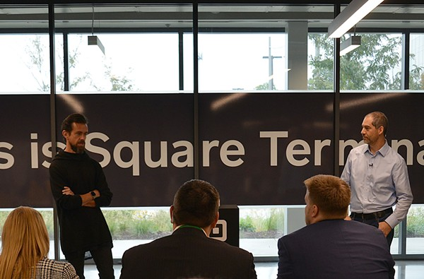"Jack Dorsey, left, and Jesse Dorogusker unveil the Square Terminal, Square's latest development in payment processing devices. Square, ""is a company focused on economic empowerment,"" Dorogusker says. - TOM HELLAUER"