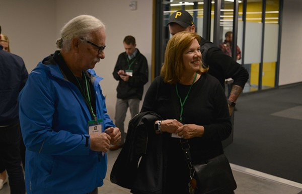 Tim, left, and Marcia Dorsey listen to local business owners rave about their son's new Square Terminal. - TOM HELLAUER