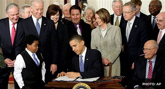 Signing federal health care into law. - VIA FACEBOOK