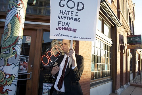 Rev. Brian Dowel protests an unrelated event.  - PHOTO BY: BILL STREETER