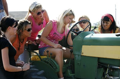 The contestants really try to figure out this tractor.