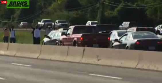 Protesters stand in the middle of I-270 near West Florissant Avenue to block traffic in honor of Michael Brown - IMAGE COURTESY OF ARGUS STREAMING NEWS