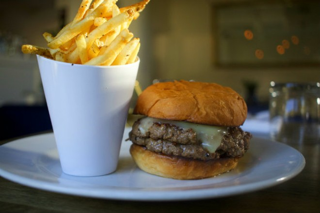 """The """"58 Burger"""" is available as either a single or a double and comes topped with white cheddar cheese. - CHERYL BAEHR"""