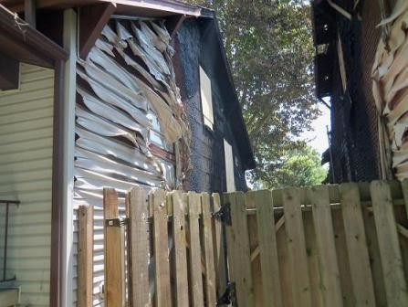 """Three weeks after a fire destroyed this home (left), the city cited the homeowner for broken windows and """"defective"""" siding."""