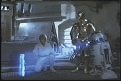 """R2-D2 introduces the world to """"sexting"""" in 1977 when he shares a hologram of the sexy Princess Leia with friends Luke and C-3PO."""