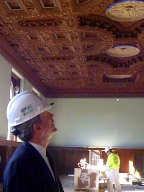 Waller McGuire admires the restored ceiling in the arts collection room. - AIMEE LEVITT