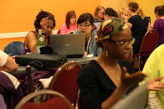The women of CoderGirl coding up a storm. - COURTESY OF LAUNCHCODE