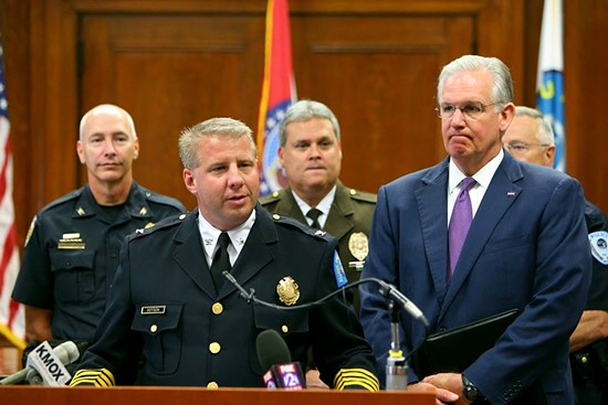 Police Chief Sam Dotson with Governor Jay Nixon, St. Louis County Police Chief Tim Fitch and others discussing their opposition to the legislation last month. - FACEBOOK / SLMPD