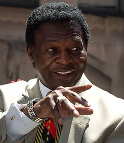 Lou Brock points the way to Little Rock.