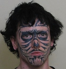 Adam Roberts and his real tattoo. - MADISON COUNTY SHERIFF'S OFFICE