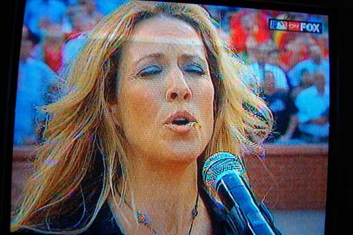 Sheryl Crow sings the national anthem...