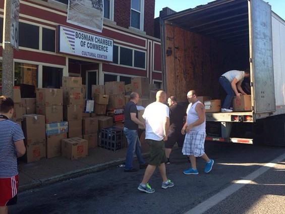 Volunteers gather supplies to ship to Bosnia after devastating floods. - COURTESY OF ST. LOUIS BOSNIAN