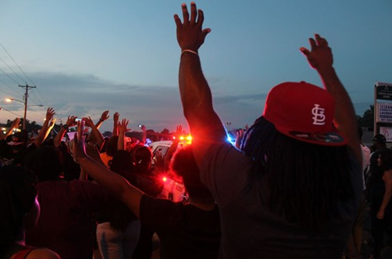 """Protesters with """"hands up."""" - RAY DOWNS"""