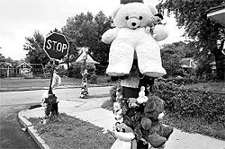 A street memorials honors Robert Walker, a 17-year-old gunned down in St. Louis in 2006. - PHOTO: JENNIFER SILVERBERG