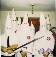 Recruiting for the KKK can get you fired.