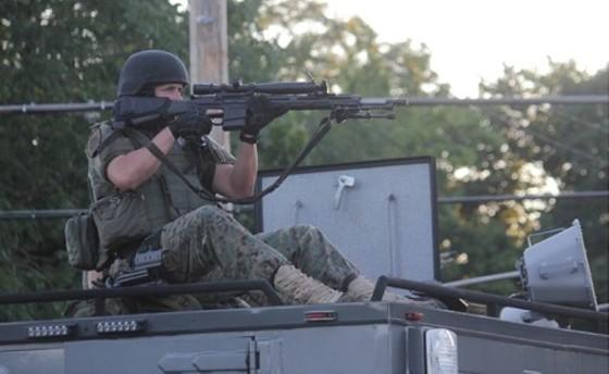 An unidentified officer last night in Ferguson. - DANNY WICENTOWSKI