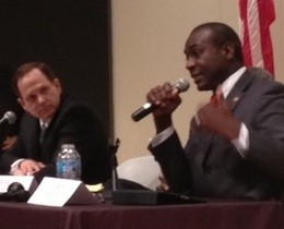 Francis Slay listens to Lewis Reed at Tuesday's debate. - SAM LEVIN