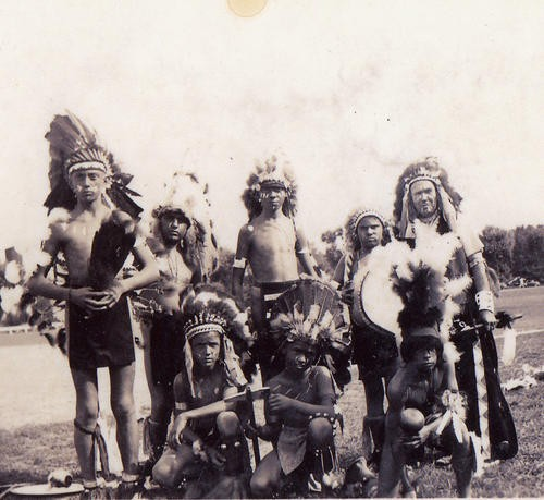 Thomas Airis (far right), grandfather of Kevin Airis, and his dancing troupe. All are wearing some of the now-missing artifacts. - COURTESY KEVIN AIRIS