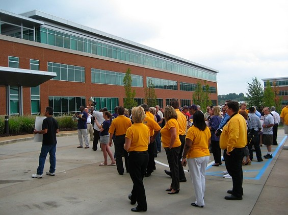Protestors at Monday's rally outside Express Scripts' headquarters near UMSL - KASE WICKMAN