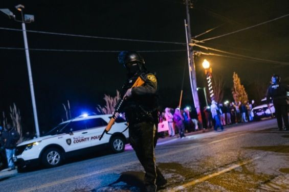 A police officer patrols Ferguson protests. Check out more photos from Ferguson in our RFT slideshow. - BRYAN SUTTER