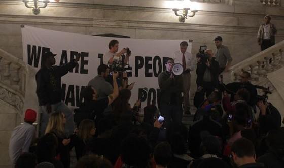 Kennard Williams, holding a megaphone, announced a list of demands sent to St. Louis mayor Francis Slay. - DANNY WICENTOWSKI