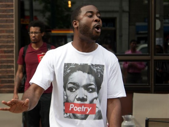 Corey Black, a St. Louis poet, throws down verses during a memorial to Maya Angelou Wednesday afternoon. - DANNY WICENTOWSKI