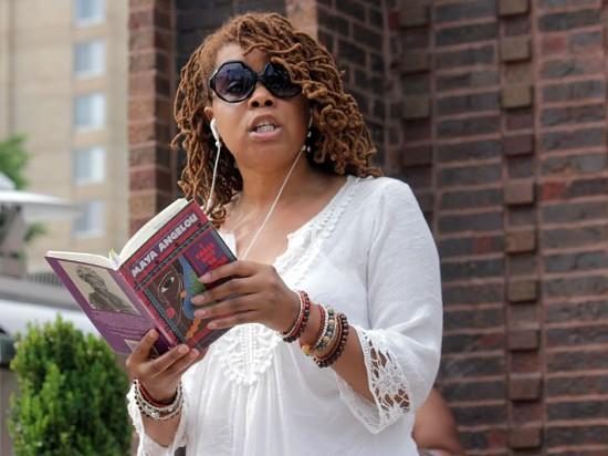 Felice Skye Hutchinson reads from one of Angelou's poetry collections. - DANNY WICENTOWSKI
