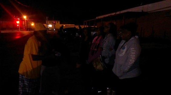 Ferguson protesters singing for Michael Brown. - RAY DOWNS