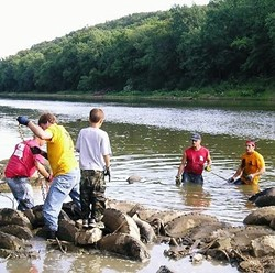 Operation Clean Stream volunteers pulling up some of the 943 car tires and 450 cubic yards of trash pulled from the Meramec and its tributaries last year.