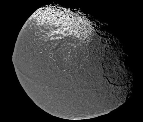 It only looks like the universe's largest walnut, but it's really Iapetus, one of Saturn's many, many moons. - IMAGE VIA