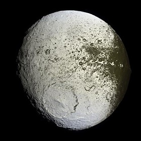 The Dark Side may be attacking Iapetus. Or it could just be bread mold. - IMAGE VIA