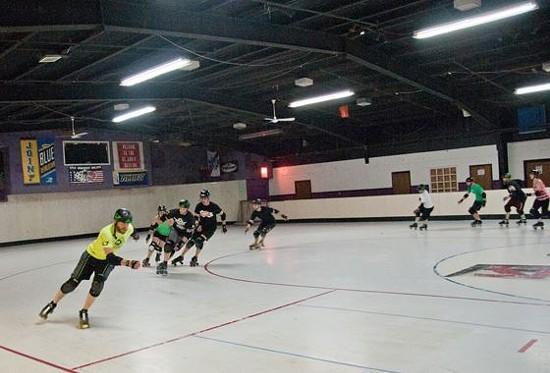 Scott Meyer (in the neon jersey) leads derbyers in drills. - CAROLINE YOO