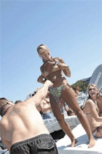"""Boobs for beads. Just another """"family-friendly"""" activity at Party Cove. - PHOTO BY JENNIFER SILVERBERG"""