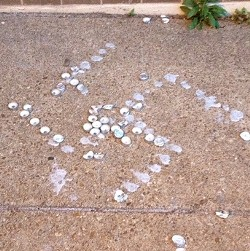 The remains of a swastika left on SLU's campus. - RYAN MCKINLEY