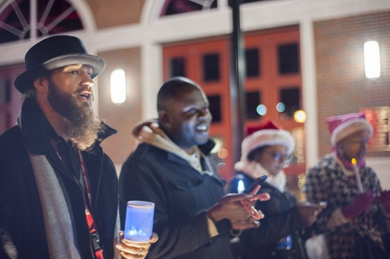 Jesse Kirk and Ray Carter sing in front of the Ferguson Fire Station on South Florissant Rd after handing out candy to local residents and fellow carolers.