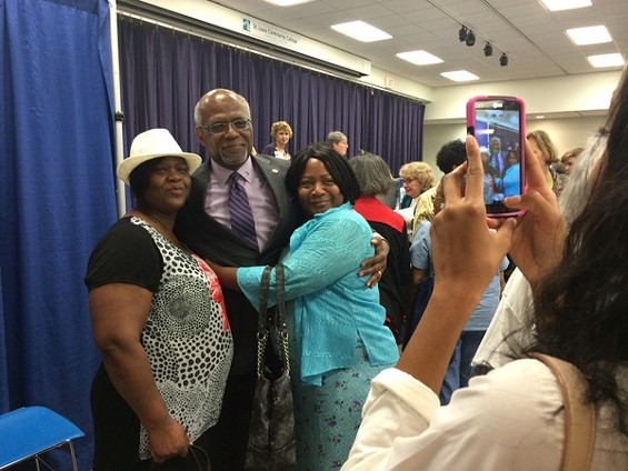 County Executive Charlie Dooley poses with supporters at the debate before the August 5 primary. - LINDSAY TOLER