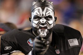 Think this fan is ugly? You should see what the men look like in Oakland. - IMAGE VIA
